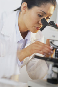 Doctor Looking into Microscope
